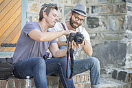 Two men with camera outdoors - ZEF008969