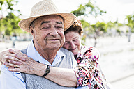 Portrait of senior man with eyes closed enjoying intimacy with his wife - UUF008038