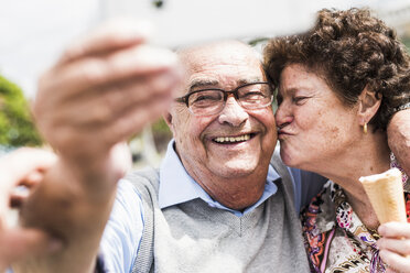 Portrait of smiling senior man taking selfie with his wife - UUF008056