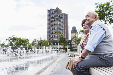 Germany, Mannheim, senior couple sitting together on a bench - UUF008074