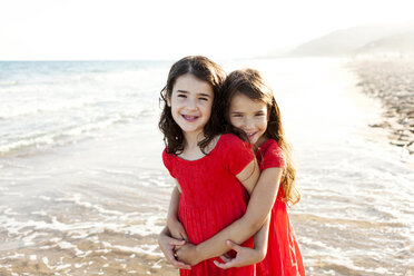 Two happy little sisters standing at seafront - VABF000690