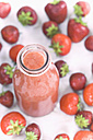 Glass bottle of strawberry smoothie and strawberries - ASF005946