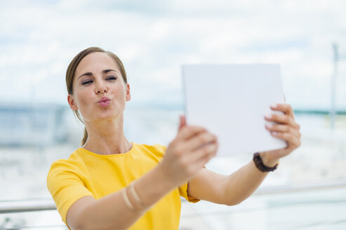 Brunette woman taking a selfie with digital tablet - DIGF000605