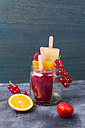 Fruits and different homemade ice lollies made of fruit juice and pulp - MYF001689