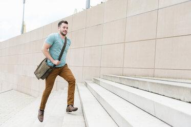 Young man running upstairs - DIGF000697