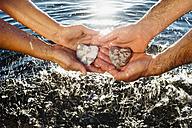Hands holding stones - MJF001981