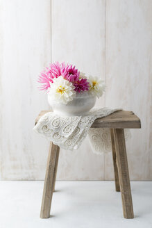 Bowl of dahlias on a stool - MYF001693