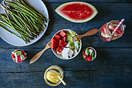 Table with salad, watermelon, lemonade, asparagus and candies - KIJF000594