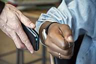 Woman paying with smartwatch and NFC reader - ONF000943