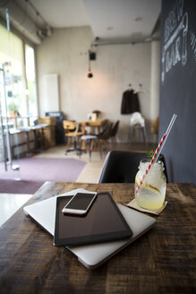 Mobile devices on table in a cafe - ONF000952