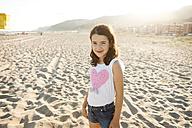 Portrait of smiling little girl on the beach - VABF000696