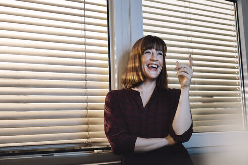 Portrait of laughing woman on window - GCF000208