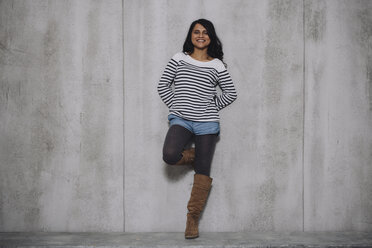 Female Indian leaning on concrete wall - GCF000226