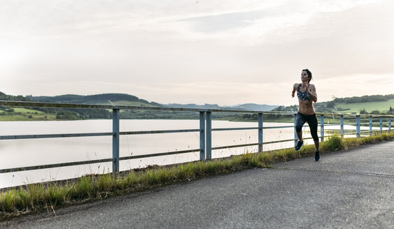 Woman running outdoors - MGOF002059