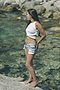 Woman with short jeans and white top - SKCF000101