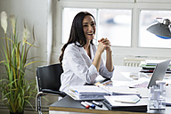 Businesswoman working in office - FKF001894