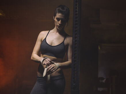 Fitness, woman in gym, ribbons - MADF001026