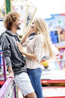 Happy couple at a funfair - GD001072