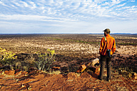 Namibia. Man with a big camera overlooking the vast plains in the african savannah from a viewpoint - GEMF000923