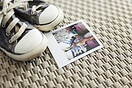 Polaroid of little boy's old shoes - VABF000710