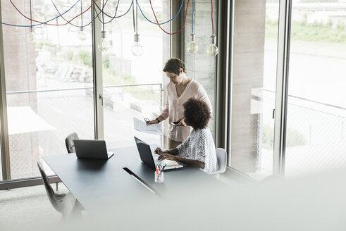 Two women in an office - UUF008215