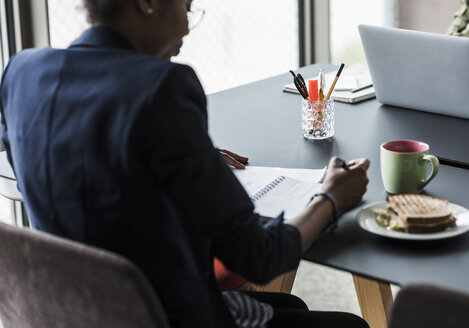 Businesswoman working at desk - UUF008251