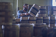 South Africa, Cape Town, cooperage, cooper piling wine barrels - ZEF009123