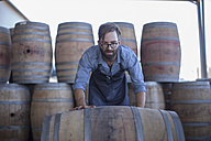 South Africa, Cape Town, cooperage, cooper rolling wine barrel - ZEF009147