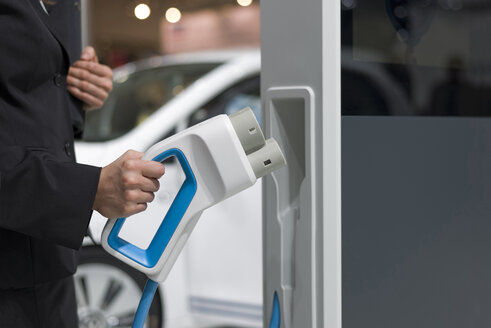 Electric vehicle charging, close-up - KLRF000423