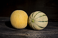 Galia and Rock melon in front of dark background - MAEF011921