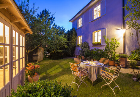 Laid table in garden in the evening - WDF003695
