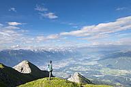 Austria, Tyrol, hiker looking to Innsbruck - MKFF000306