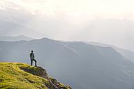 Austria, Tyrol, hiker looking at distance - MKFF000312