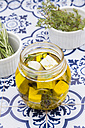 Glass of diced sheep cheese pickled in olive oil, thyme, garlic, pepper and rosmary - LVF005144