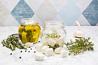 Glass of diced sheep cheese pickled in olive oil, thyme, garlic, pepper and rosmary - LVF005147