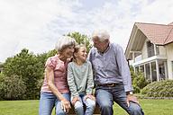 Happy grandparents with granddaughter in garden - RBF004756