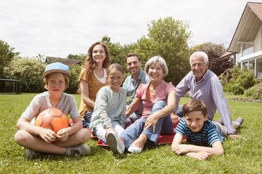Portrait of happy extended family in garden - RBF004759
