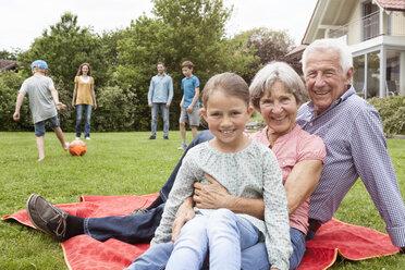 Portrait of happy extended family in garden - RBF004765