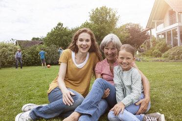 Portrait of happy extended family in garden - RBF004768