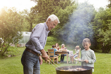 Grandfather and granddaughter on a family barbecue - RBF004771