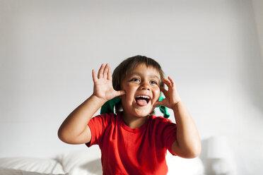 Portrait of little boy pulling funny faces - VABF000713