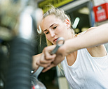 Young woman repairing motorbike - MADF001033