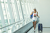 Vietnam, Ho Chi Minh city, young woman in airport - KNTF000435