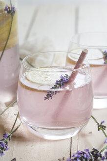 Lemon lavender lemonade in glass with drinking straw - SBDF003051