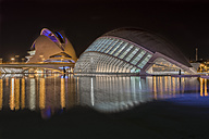 Spain, Valencia, lighted L'Hemisferic and Palau de les Arts Reina Sofia at City of Arts and Sciences by night - LOM000321