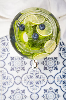 Glass of infused water with lime, blueberries and mint - LVF005175