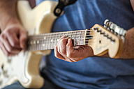 Close-up of man playing guitar - DIGF000777
