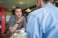 To young men socializing in a cafe - DIGF000804