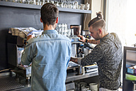 Two men preparing coffee in a cafe - DIGF000807