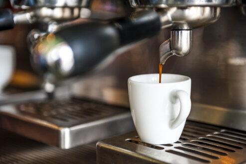 Espresso machine preparing cup of espresso - DIGF000810